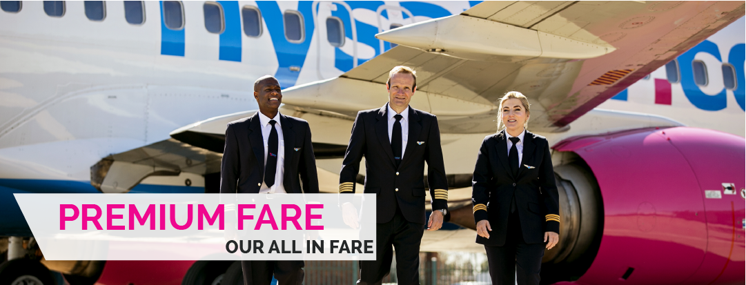 two male and one female pilot in full uniform standing in front one of FlySafair's aircraft