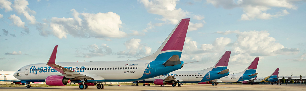 FlySafair aircraft fleet line-up at their base of operations at OR Tambo Int. Airport
